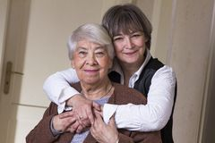 Happy old woman with daughter. Happy old women at home with daughter Stock Photo