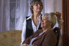 Happy old woman with daughter. Happy old women with daughter at home Stock Photo