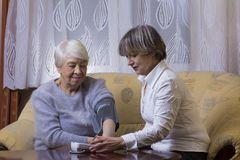 Happy old woman with daughter. Happy old women with daughter at hope Stock Photography