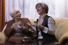 Happy old woman at home. Happy old women at home with daughter Stock Images