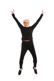 Happy old woman jumping. Isolated on white Stock Photos
