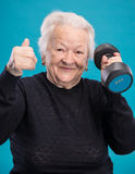 Happy old woman making fitness training with dumbbells Royalty Free Stock Images