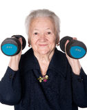 Happy old woman making fitness training with dumbbells Stock Image