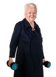 Happy old woman making fitness training with dumbbells Royalty Free Stock Image
