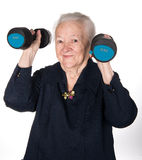 Happy old woman making fitness training with dumbbells Royalty Free Stock Photos