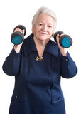 Happy old woman making fitness training with dumbbells Stock Photo