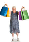 Happy old woman with shopping bags Stock Photo