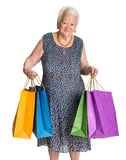 Happy old woman with shopping bags Royalty Free Stock Photography