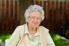 Happy Old Woman Sitting And Relaxing Royalty Free Stock Images