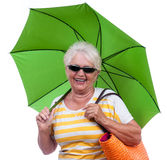 Happy old woman with umbrella Stock Images