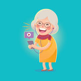 Happy Old Woman Watch Movie From Smart phone Stock Photos