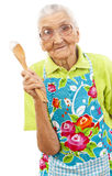 Happy  old woman with wooden spoon Royalty Free Stock Images