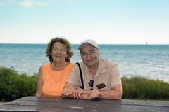 Happy Older Couple. Happy smiling older couple outdoor by a lake Stock Images