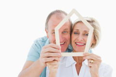 Happy older couple holding house shape Stock Photography
