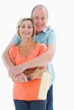 Happy Older Couple Holding Paint Roller Stock Photography