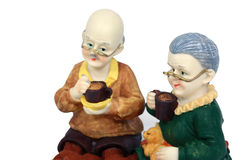 A happy older couple. Statue sitting and take a coffee together Royalty Free Stock Photos