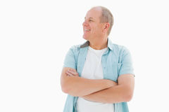 Happy older man with arms crossed. On white background stock photo