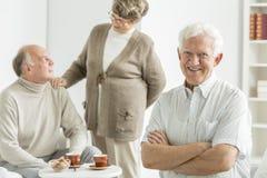 Happy older man. Happy older men in a white cozy nursing home stock images