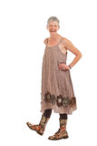 Happy older woman in flowered boots and dress Stock Photos