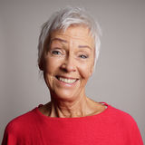 Happy older woman in her 60s royalty free stock image