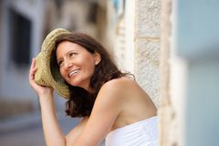 Happy older woman laughing with hat outside. Close up portrait of a happy older woman laughing with hat outside Stock Photography