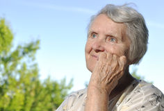 Happy older woman looks up at the sky. Royalty Free Stock Photography
