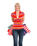 Happy older woman with shopping bags Stock Images