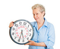 Happy older woman with time on her hands Stock Photography