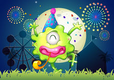 A happy one-eyed monster at the carnival with a firework display. Illustration of a happy one-eyed monster at the carnival with a firework display Stock Image