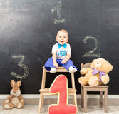 Happy one year old boy takes first place on the podium Stock Photo