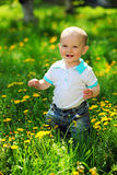 Happy one-year old boy on a walk in a park Stock Photo