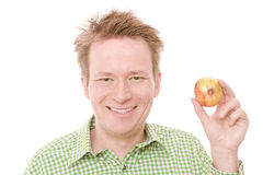 Happy onion. Young happy smiling man holding an onion - isolated on white and retouched Stock Photo