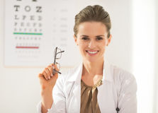 Happy ophthalmologist doctor woman with eyeglasses Royalty Free Stock Photo