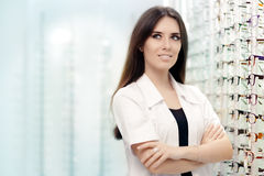 Happy Optician Choosing between Glasses and Contact Lenses Stock Photos