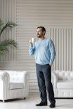 Happy optimistic man enjoying his tea Royalty Free Stock Images
