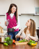Happy ordinary women cooking food Royalty Free Stock Photo