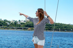 Happy overjoyed woman on a boat. summer trip on a yacht Royalty Free Stock Images