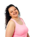 Happy overweight girl. Portrait of laughing obese teen girl. Isolated on white background royalty free stock photography