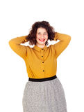 Happy overweight girl touching her hair. Isolated on a white background royalty free stock image