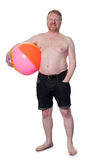 Happy overweight middle aged man with beach ball Stock Image