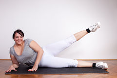 Happy overweight woman exercising Stock Image