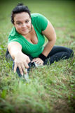 Happy plus size woman stretching Royalty Free Stock Photography