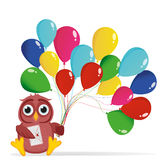 A happy owl with colorful balloons on the green grass. Greeting card Stock Images