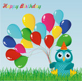 A happy owl with colorful balloons on the green grass. Greeting card Royalty Free Stock Images