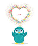A happy owl throws a multicolored confetti in the shape of a hearts Royalty Free Stock Photo