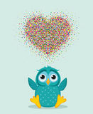 A happy owl throws a multicolored confetti in the shape of a hearts Royalty Free Stock Photography