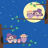 Happy owls family sitting on a tree branch - Illustration. Happy owls family sitting on a tree branch at night - Illustration Royalty Free Stock Photography