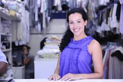 Happy owner of a dry cleaning service Royalty Free Stock Photo