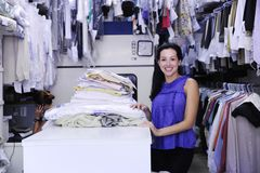 Happy owner of a dry cleaning service. Small business: happy owner of a dry cleaning service royalty free stock photo
