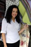 Happy owner of a fabric store. Small business: happy owner of a fabric store royalty free stock image